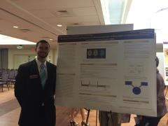 Andrew presenting his poster at the Honors College Research Poster Showcase!